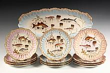 (12) LIMOGES FISH PLATES & MATCHING PLATTER - Hand painted Plates, no two the same, with scalloped and fluted edges, four each of pale