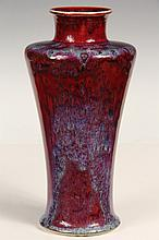 ART POTTERY VASE - High Fired Art Pottery Vase by Ruskin, dated 1913, with oxblood or sang de boeuf glaze; impress marked on base 'Rus