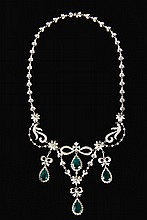 NECKLACE - 18K White Gold, Diamond and Emerald Necklace, (4) pear shaped emeralds suspended from diamond set ribbon forms, emeralds wei