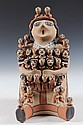 NATIVE AMERICAN POTTERY FIGURE - Large Storyteller Figure by T. Sando, Jemez Pueblo, NM, having thirty children on the seated maternal