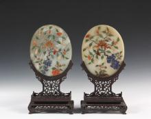 PAIR OF CHINESE JADE TABLETOP SCREENS - Early 20th c. Chinese Oval White Jade Screens, with applied floral design in agate, spinach jade, coral, lapis lazuli and other semiprecious stones, opposing images, set into th...