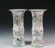 PAIR OF CHINESE VASES - Porcelain Gu Form Vases with broad flared rims, Mandarin decoration of families in gardens at top, deer at bottom of one, rooster at bottom of other, both with bands of red inscription at belly...