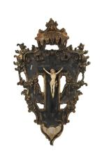 17TH C SPANISH VOTARY, CARNEGIE PROVENANCE - Baroque Crucifix with Font, in carved gilt and polychromed wood, having a beautifully detailed Corpus Christi mounted on an ebony cross, laid to the plaque which is surmoun...