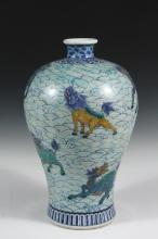CHINESE PORCELAIN VASE - Ming Dynasty Style, Yongle mark Meiping form vase, Wucai decorated with polychrome Kylin over wave patterns, in blue and red, having blue geometric banded collar and base, underglaze six-chara...