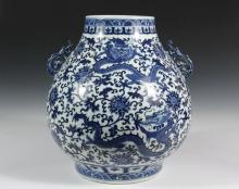 CHINESE PORCELAIN VASE - Qing Dynasty Style, Yongzheng mark, Bailuzun form, with blue and white decoration of writhing three-toed front-facing dragons in fields of blossoms and vines, wave and ruyi banded top and foot...