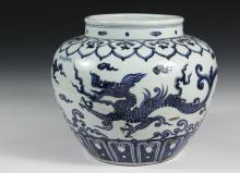 CHINESE PORCELAIN VASE - Qing Dynasty Style, Blue & White Squat Porcelain Vase, six-character Kangxhi mark on side, painted with a continuous scene of long dragons chasing pearls, between bands of ruyi tabs, 12 1/4