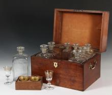 EARLY SHIP OFFICER'S LIQUOR CHEST - Late 18th c. to early 19th c., probably English, in mahogany, with conch shell inlay centered on the hinged lid, nickel plated brass end lifts, shield form bone lock escutcheon, the..