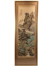 FRAMED CHINESE SCROLL PAINTING - Late 19th - early 20th c. watercolor and ink on silk, depicting an extensive mountain landscape with a single figure on a bridge and one structure tucked into trees, signed, with seal ...