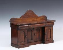 APPRENTICE MADE MINIATURE SIDEBOARD MODEL - 19th c. American Federal Sideboard in solid walnut, with a high shaped backsplash, overhanging top, three cylinder front drawers, outside cabinets and stepped back center ca...