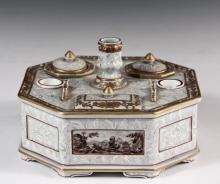 PORCELAIN DESK STAND - 19th c. German or French Desk Stand, in octagonal form, pale celadon green having raised white floral decoration, gilt and red pinstriped edging, four hand painted landscapes on the fascia, cont...