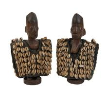 PAIR OF AFRICAN FIGURES - Pair of Ibeji Twin Carvings in wood, Yoruba peoples, Igbomina area, Nigeria, one male, one female, in their original cowry shell coats (representing wealth) with silver bracelets. 11