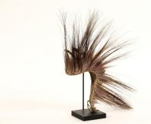 NATIVE AMERICAN HEADDRESS - Late 19th c. Sioux Man's Roach in porcupine hair bound by plaited grass, with bone plate and receiver for a single feather. On stand. Roughly 13