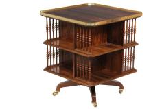 REVOLVING BOOKCASE - Replica Victorian Central Bookcase, in rosewood, square with clipped corners, the top having figured center with cross banded mahogany edge and a solid brass gallery, two shelves in figured rosewo...