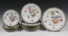 (18 PCS) ROYAL BERLIN PORCELAIN - Partial KPM Service, circa 1880, having the blue sceptre mark, hand painted with blossoms and insects, with gilt lace edge over raised basketweave border, including: Oval Fish Platter...