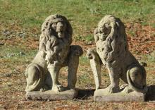 PAIR OF MEDIUM SEATED LION GARDEN STATUES - Cast Stone Seated Lions in opposing stances with one paw resting on a shield, 20