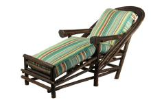 ADIRONDACK CHAISE LOUNGE - Circa 1900 Cottage Made Bent Twig with bark off, lightly varnished, having quadrupled back hoops, root base trunk arms, cushion fence at foot, having custom made striped cotton cushions