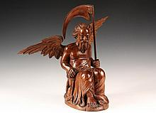 CONTINENTAL FOLK CARVING - Allegorical Figure of Father Time, seated, with wings spread and scythe raised in left hand, solid mahogany with applied wings and scythe, circa 1850, roughly 16