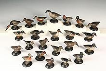 RARE SET OF (23) MINIATURE DECOYS - Rare Set of Carved and Painted Wood Miniature Ducks by A