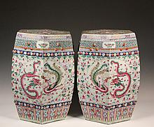 PAIR OF CHINESE GARDEN SEATS - Outstanding Porcelain Garden Seats in octagonal barrel form, with pierced double coin fortune decoration and raised bosses, slightly recessed top, polychrome glaze, having pairs of drago...