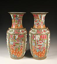 PAIR OF CHINESE FLOOR VASES - Large Rose Medallion Porcelain Baluster Vases, ca 1890, decorated with alternating panels of Mandarin court scenes and flowers and birds, having gilt rim and faux drop ring foo dog lugs