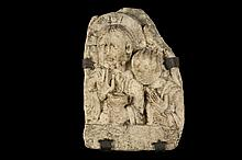 STONE BAS RELIEF - An Important French Romanesque Carved Stone Architectural Fragment, depicting Christ holding the Chalice of Life, one hand raised in benediction, with an Innocent Child at his shoulder; having an ea...