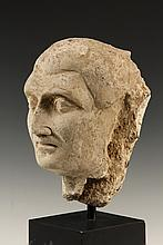 CENTRAL ASIAN SCULPTURE - Head of a Mature Male, Gandharan, Pakistan, 4th century AD, in carved stucco, a Patrician in the Roman style, on a museum mount