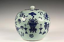 CHINESE PORCELAIN JAR - Late 19th c Covered Ginger Jar in celadon with raised blue and white decoration of scholars furnishings, the small lid having a bulbous knop, retaining a Christies East sticker. 9 3/4