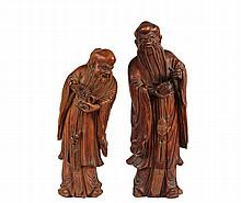 (2) CHINESE WOOD CARVINGS - Standing Figures of Shou Lao, the God of Longevity, late 18th to early 19th c, each holding a peach, with open opposing hand that would have held staff, 7