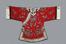 CHINESE ROBE - Lady's Formal Robe, Late Qing, circa 1890, in fine crimson silk figured damask, with embroidered decoration of repeating medallions containing women in gardens, flanked by dragon and phoenix, interspers..