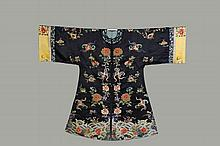 CHINESE ROBE - Man's Informal Robe, Late Qing, ca 1900, in dark blue flat silk satin, having overall opposing embroidered polychrome decoration of blossoms, moths and auspicious symbols, ocean pattern at the bottom, w..