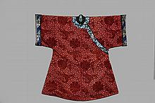 CHINESE ROBE - Man's Brocade Winter Coat, Late Qing, ca 1890, in brick colored cut velvet silk, having prunus and blossoms suspended over a keyed field, with black standing collar, white and blue embroidered blossom c..