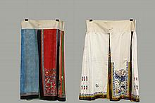 (2) CHINESE SKIRTS - Summer Skirt, late Qing, circa 1900, in multi-colored pillow pleats with embroidered scattered blossoms, central crimson panel in figured damask with embroidered figures in garden, wide black band...