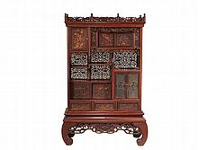 JAPANESE CURIO CABINET - Two-Part Floor Standing Curio Cabinet, in delicately carved hardwood, having a family mon on one set of cabinet doors, overall reticulation that uncommonly is nearly entirely intact, including...