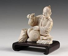 JAPANESE OJIME - 19th c. Meiji Period Figure of a Seated Lantern Decorator, startled by a rat landing on his brush hand, unsigned, bamboo branch on bottom, on carved wooden base, 3 1/8