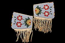 NATIVE AMERICAN BEADED GAUNTLETS - Cree Polychrome Floral Gauntlets on buckskin, having a pale blue fully beaded field, lined with cotton chintz, circa 1900-1910. 8 1/2