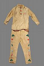 NATIVE AMERICAN CLOTHING - Great Lakes / Chippewa Beaded Buckskin Shirt and Pants, having vining blossom and leaf polychrome decoration, designs following red pattern lines, secured to interior paper backing, pants ha...