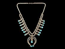 NECKLACE - Native American Silver and Turquoise Squash Blossom Necklace crafted by Navajo Maker Doris Smallcanyon, with double strand of hollow beads, (14) squash blossoms set with polished natural turquoise, and naja...