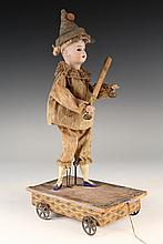RARE AUTOMATON PULL TOY - Schoneau & Hoffmeister German Bisque Head Clown with Slap Stick on Pull Cart, having articulated arms, with trademark on back of neck for S&H, Porzellan Fabrik Burggrub, mold number 46