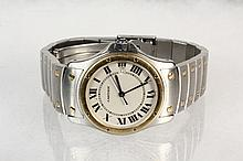 WRISTWATCH - Cartier 18K Yellow Gold and Stainless Steel 1551 Cougar Model Santos Ronde Wristwatch, Roman numeral dial, blue sapphire cabochon on winding crown, with original link band, sn CC251601, 1 1/8