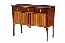 SIDEBOARD - Circa 1900, Fine Bench Made Centennial Mahogany Hepplewhite style Tambour Sideboard, custom made after an example by John Seymour. Satinwood and ebony inlaid top banding, three drawer front, brass floral m...