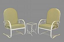 PAIR OF WROUGHT IRON PATIO SPRING CHAIRS WITH STAND - Circa 1950s White Painted Strap and Rod Construction, having scrollwork decoration, including: Tombstone Back Sprung Rockers, loose green cushions, 18