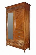 ARTS AND CRAFTS WARDROBE - American Yellow Pine 'Cottage' Cabinet with flat molded cornice, chip carved frieze and stiles, long beveled mirror door on left, diagonal bead and board paneled door at right with three dra.