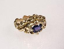 GENT'S RING - Rare Art Nouveau Ring in 14K Yellow Gold depicting a creature holding an oval sapphire in its mouth. Size 8 1/4; 7.8 dwt tw. Fine condition.