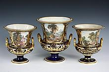 SET OF (3) CROWN DERBY TOPOGRAPHICAL URNS - Campani Form Urns in cobalt blue with gilt decoration and octagonal scenic views, gilt coiled snake handles, one large, two small, all well marked, including: 8