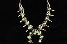 SQUASH BLOSSOM NECKLACE - Vintage Native American Metal and Chunky Green Turquoise Squash Blossom Necklace, with double strand of hollow beads, (10) squash blossoms, and (7) stone naja. 25 1/2