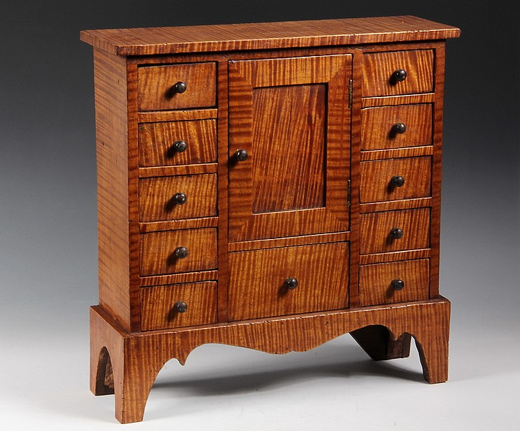 "SPICE CABINET - Curly Maple Spice Cabinet, 19th c New England, original ebonized knobs, set on a high cutout bracket base, 16 1/2"" tall"