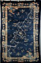 CHINESE RUG - Oblong Chinese Rug in deep blue with overall floral decoration, scattered fortune symbols, exotic birds in two corners, s