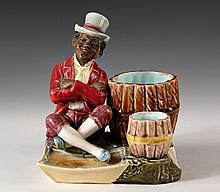 MAJOLICA FIGURAL SMOKING STAND - American Advertising Piece with Black Dandy sitting at bundles of cigars that held cheroots & matches,