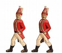 PAIR OF HESSIAN ANDIRONS - Replica Cast-Iron Traditional Andirons in the form of a marching German soldier, in red, white & grey paint.