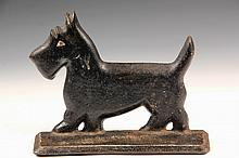 CAST IRON DOG DOORSTOP - Art Deco Flange Form Scottie Dog in black paint with a white eye, stamped